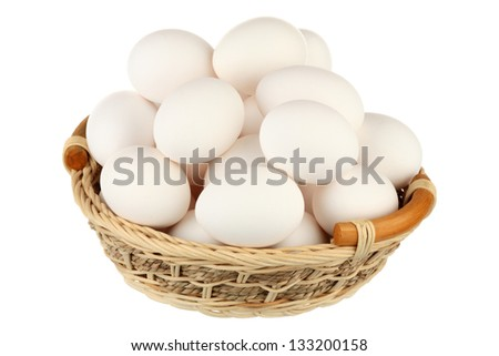 Eggs in a basket over white background - stock photo