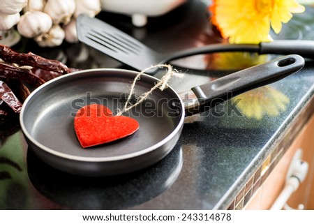 Eggs in a frying pan for Love or Heart Healthy Cooking Concept - stock photo