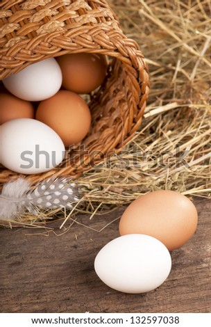 eggs in a nest on wooden background
