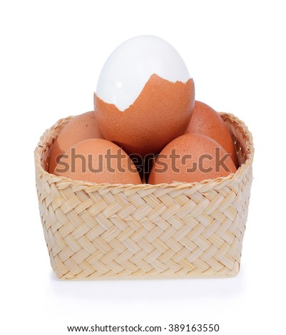 Eggs in bamboo basket isolated on white background. - stock photo