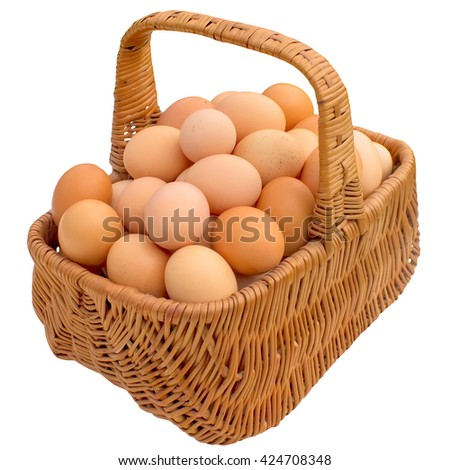 Eggs in basket isolated on white background. - stock photo