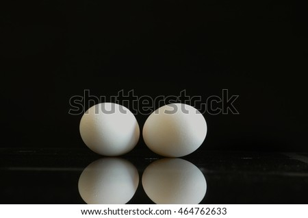 Eggs  in black background.