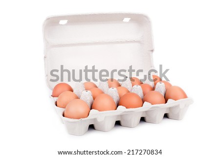 Eggs in cardboard packaging isolated on white background - stock photo