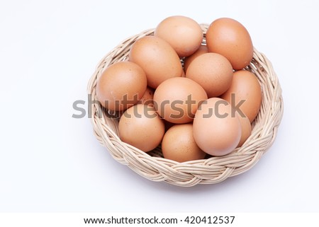 Eggs in the basket on white background, top view.