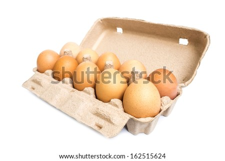 Eggs in the box isolated on white  - stock photo