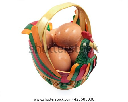 Eggs In The Hen Basket (Isolated and  Selective Focus) - stock photo