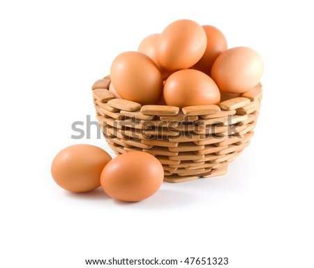 Eggs in wooden bowl. White background. Isolated path included.