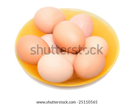 Eggs in yellow glass bowl over white