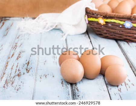 Eggs is  isolated on wooden table - stock photo