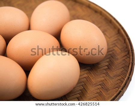 Eggs Lay On The Wooden Flat Basket (Isolated and Closeup) - stock photo