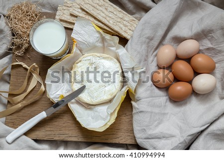 Eggs, milk and butter in kitchen