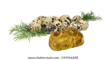 Eggs of quail with greens and small loaf of bread on white background - stock photo