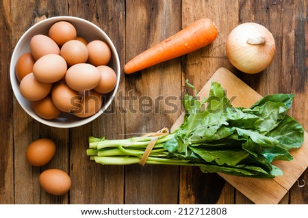 eggs on a wood background with vegetable - stock photo
