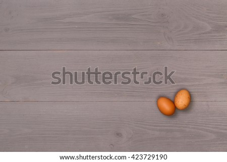 Eggs on a wooden table top view. Natural eco food. Gray, wooden table top view. On the table are the food for cooking. Healthy food. Dietetic foods. Delicious breakfast. Traditional food. - stock photo