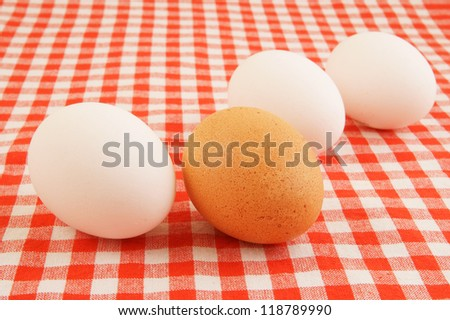 Eggs on red checked tablecloth