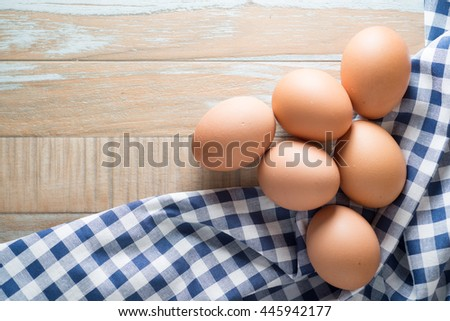Eggs on wooden background with selective focus