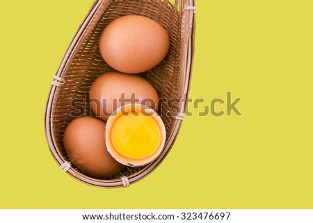 eggs on yellow background with copyspace