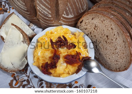 Eggs - scrambled eggs with sun dry tomatoes, bread and butter