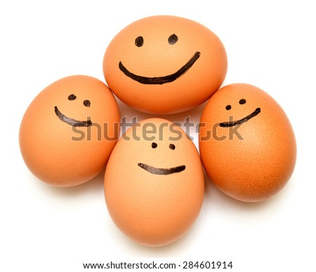 Eggs smiling family of eggs isolated on white background - stock photo
