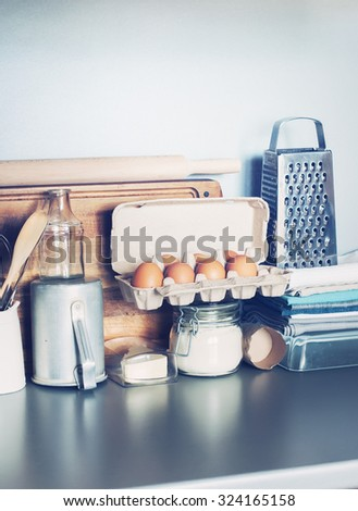 Eggs, Table Ware, Grocery, Different Stuff on Kitchen Table-top. Toned vertical image - stock photo