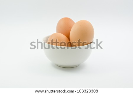 Eggs,Three eggs in the bowl on white background - stock photo