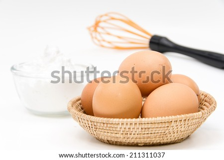 eggs ,whisk and flour on white
