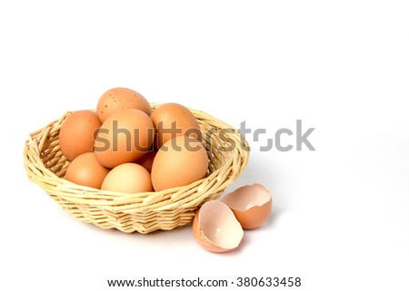 Eggs with broken shells isolated on white background. - stock photo