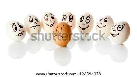 Eggs with funny faces isolated on white - stock photo