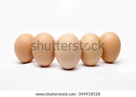 Eggs with white background. Isolated. Focus point on the egg at center. Slightly shallow depth of field - stock photo