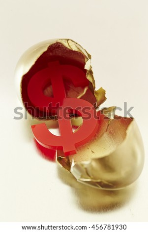 Eggshell with US dollar currency symbol