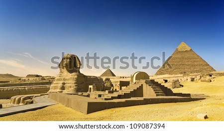 Egypt. Cairo - Giza. The Sphinx, the Pyramid of Khafre (Chephren) and Menkaure (Mykerinos) in background. The Pyramid Fields from Giza to Dahshur is on UNESCO World Heritage List - stock photo