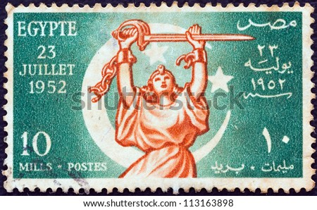 "EGYPT - CIRCA 1952: A stamp printed in Egypt from the ""Revolution of 23rd July 1952"" issue shows Allegory of Egyptian freedom, circa 1952. - stock photo"