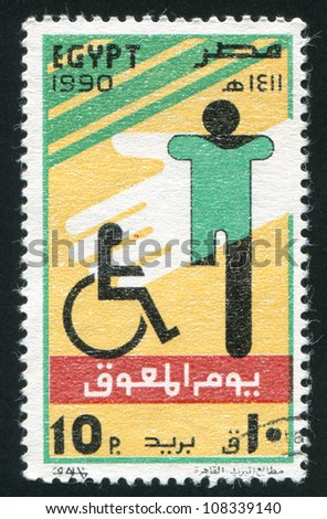 EGYPT - CIRCA 1990: stamp printed by Egypt, shows Day of the Disabled emblem, circa 1990 - stock photo