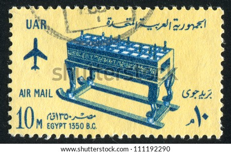 EGYPT - CIRCA 1965: stamp printed by Egypt, shows Game Board from Tomb of Tutankhamen, circa 1965 - stock photo
