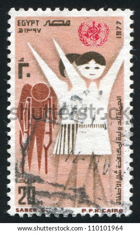 EGYPT - CIRCA 1977: stamp printed by Egypt, shows Girls, disabled person, emblem, circa 1977 - stock photo