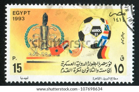 EGYPT - CIRCA 1993: stamp printed by Egypt, shows Soccer ball, Trophy, National flags, circa 1993 - stock photo