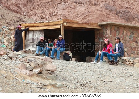 EGYPT - FEBRUARY 5: Tourists rest on their way up to Mount Sinai on February 5, 2011 in Egypt. Daily, hundreds of tourists and pilgrims flock to the 2285m Moses mountain to enjoy sunrise & sunsets. - stock photo