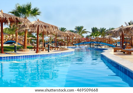 Egypt, Hurghada - November 10, 2014. Nice view of the swimming pool and deck chairs and thatched umbrellas