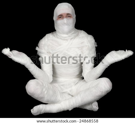 Egypt mummy in pose lotus on black background - stock photo