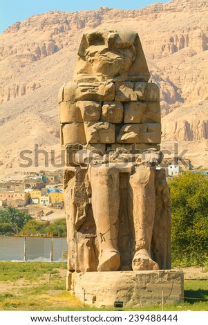 Egypt, Upper Egypt, Nile Valley, Gaugue bank of Thebes, about Luxor, Colossi of Memnon classified World Heritage - stock photo