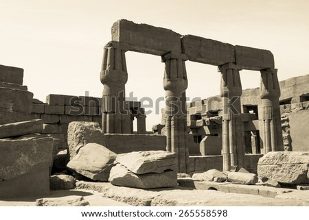 Egyptian ancient architecture, toned colors. Egypt, columns in Karnak Temple, ruins of landmarks. Vintage photo, monochromatic colors in retro style. - stock photo
