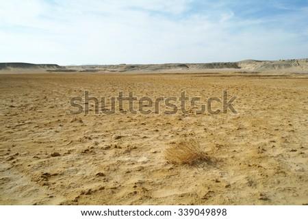 Egyptian Desert and blue sky - stock photo