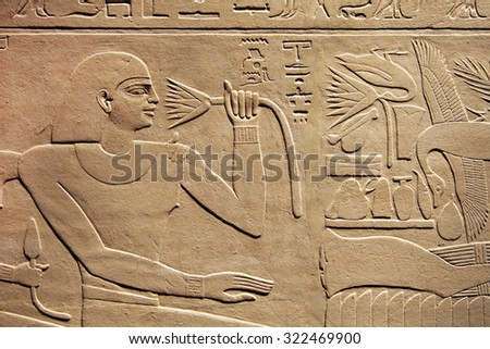 Egyptian hieroglyphic carving of a man - stock photo