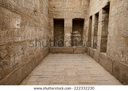 Egyptian hieroglyphic carvings in a chamber at the temple of Medinat Habu in Luxor - stock photo