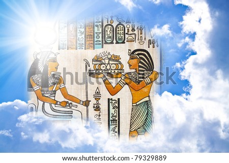egyptian pharaoh in the clouds in sun beams - stock photo