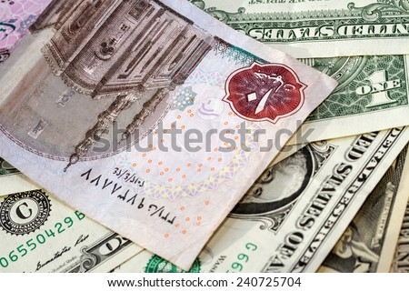 Egyptian pounds and American dollars closeup