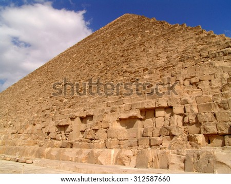 Egyptian pyramid. A look from below up on a pyramid. - stock photo