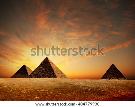 Egyptian pyramids on a sunset - stock photo