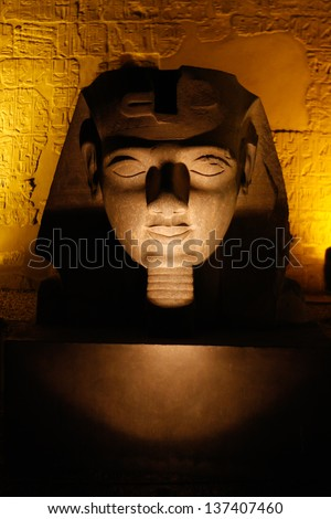 Egyptian sculpture Ramses' colossus head at Luxor temple, Thebes - stock photo