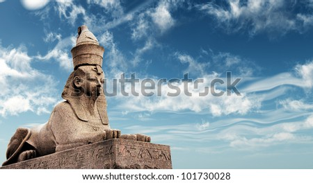 Egyptian Sphinx on blue sky background - stock photo